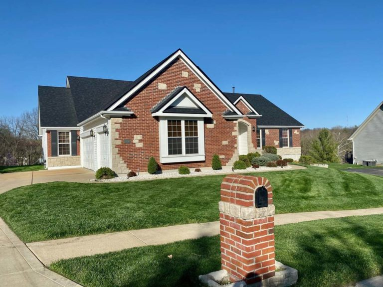 one-story brick home new black roof